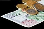 billete-de-mil-pesetas-con-monedas-de-euro-107368